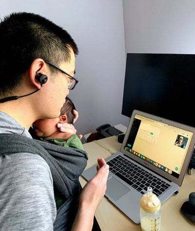 Dr. Billy Lin, who returned early from parental leave, providing telemedicine while feeding his newborn. Photo credit: Billy Lin; author provided.