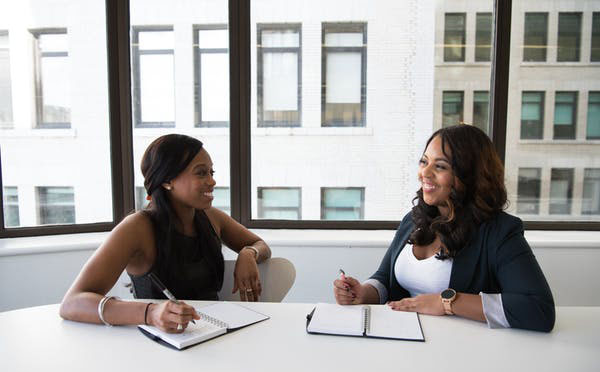 More women in top positions reassures potential women CEOs that there is less risk of being terminated. Photo credit: Christina Wocintechchat/Unsplash.