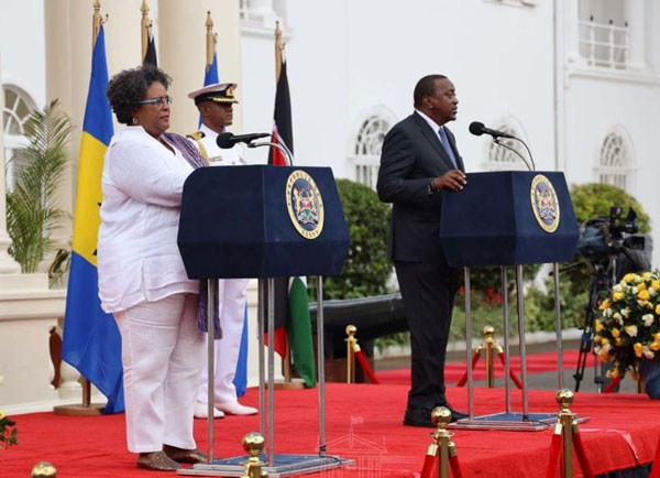 Chair of CARICOM and Barbados Prime Minister, Mia Amor Mottley, said, that although the coronavirus pandemic had caused the postponement of the inaugural CARICOM/African Union Summit in Nairobi, next month, she was still committed to deepening the region's relationship with Africa. Here, she is pictured with Kenyan President, Uhuru Kenyatta, in December last year. Photo credit: GP.