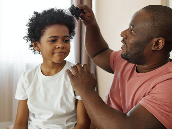 Fathers can use the time they spend with their boys during the coronavirus lockdown to promote a more caring definition of masculinity. Photo credit: August de Richelieu/Pexels.