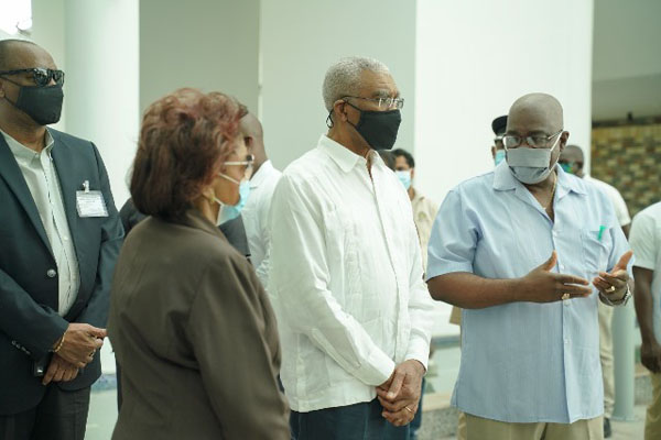 President Granger (centre); Joseph Harmon (left), Chief Executive Officer of the National COVID-19 Task Force (NCTF); Chair of the Guyana Elections Commission GECOM) (retd) Justice Claudette Singh (second from left); and Chief Elections Officer, Keith Lowenfield, during the Head of State's visit to the recount centre. Photo credit: DPI.