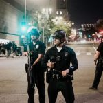 Armed police, with body cameras in place, respond to anti-police violence on the streets of Los Angeles, California. Photo credit: Sean Lee/Unsplash.
