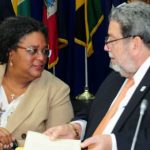 Outgoing CARICOM Chair and Barbados' Prime Minister, Mia Amor Mottley, and incoming Chair, Dr. Ralph Gonsalves, Prime Minister of St. Vincent and the Grenadines. Photo credit: BGIS.