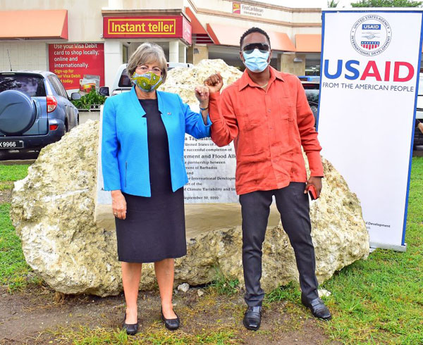 Minister of Environment and National Beautification, Adrian Forde, and United States Ambassador to Barbados, Linda Taglialatela, celebrate the completion of the flood alleviation project at Sunset Crest, St. James yesterday. Photo credit: C. Pitt/BGIS.