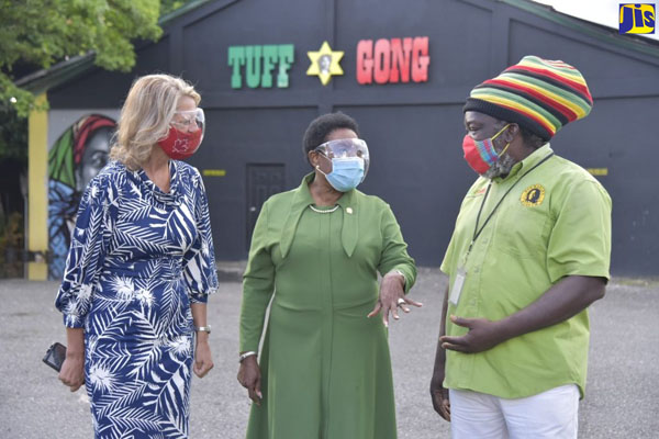 Minister of Culture, Gender, Entertainment and Sport, Olivia Grange (centre), makes a point to tour guide at Tuff Gong Studios, Ricky Chaplin. Listening on is Canadian High Commissioner to Jamaica, Laurie Peters. Photo credit: Donald De La Haye/JIS.
