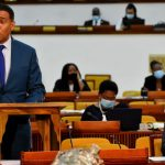 Prime Minister,. Andrew Holness (at lectern), highlights a point, while making a statement regarding recent heavy flood rains, during the sitting of the House of Representatives on Tuesday. Also pictured (at right) is Minister of Tourism, Edmund Bartlett. Photo credit: Mark Bell/JIS.