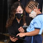 Member of Parliament for East Portland, Ann Marie Vaz, shows litte Kyanna Bailey of Boundbrook Infant School, how to use a tablet. The occasion was the handover of devices under the Tablets in Schools Program, during a ceremony at the Port Antonio Primary School in Portland, yesterday (October 22). Photo credit: Adrian Walker/JIS.
