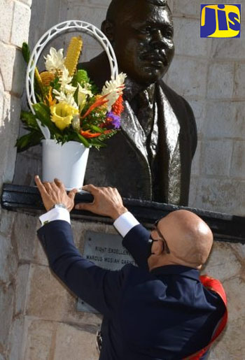 Governor-General, Sir Patrick Allen, places flowers at the shrine of National Hero, Marcus Mosiah Garvey, during a ceremony at National Heroes Park on Monday (October 19). The event formed part of activities commemorating National Heroes' Day. Photo credit: Mark Bell/JIS.