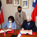 Trinidad and Tobago's Minister of Trade and Industry, Senator Paula Gopee-Scoon (left), signs the Agreement with Chile's Ambassador, Juan Aníbal Barría.