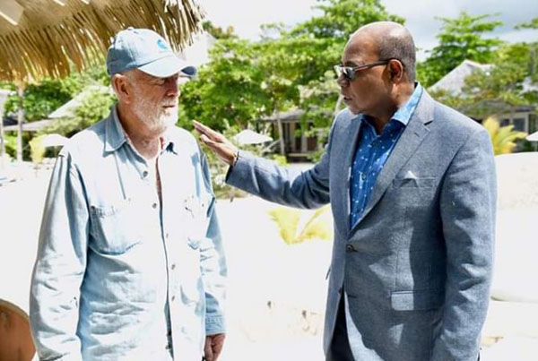 Minister of Tourism, Edmund Bartlett (right), and GoldenEye's owner and music mogul, Chris Blackwell, at the launch of the James Bond movie, No Time To Die, at GoldenEye resort in 2019. Photo contributed.