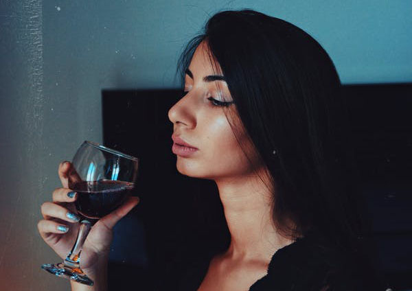 Do you tell yourself you need a glass of wine to relax? Experiment with new methods. Photo credit: Ana Itonishvili/Unsplash.