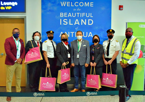 The Air Canada captain and crew are welcomed, by Minister of Tourism, Charles Fernandez (fourth from right), and other tourism officials, on the airline's first flight back to Antigua and Barbuda, since March.