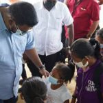 Guyana's President, Dr. Mohamed Irfaan Ali, meets with residents of Kato, including children, during his informal visit, yesterday.