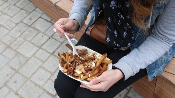 Poutine is fast food, friendly, joyful and associated with nightlife. Photo credit: Francisca Alvarez/Unsplash.