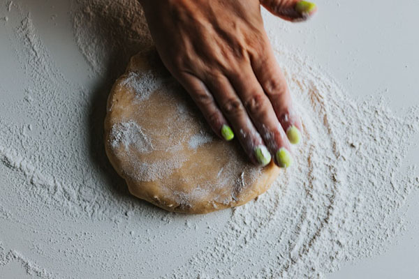 Baking bread is both a way to stay occupied and a useful life skill. Photo credit: Nathan Dumlao/Unsplash.