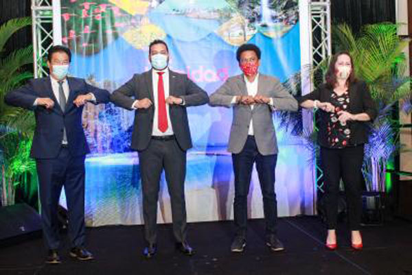 """Tourism Minister Mitchell (second from left); TTL Chair Lee; and two tourism officials exchange coronavirus-inspired """"elbow shakes"""" at the website launch."""