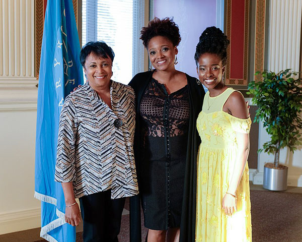 National Youth Poet Laureate, Amanda Gorman (right); Librarian of Congress, Carla Hayden; and Poet Laureate, Tracy K. Smith, attend a reception, prior to the opening reading of Smith's 2017-2018 term, on September 13, 2017. Photo credit: Shawn Miller; Public Domain.