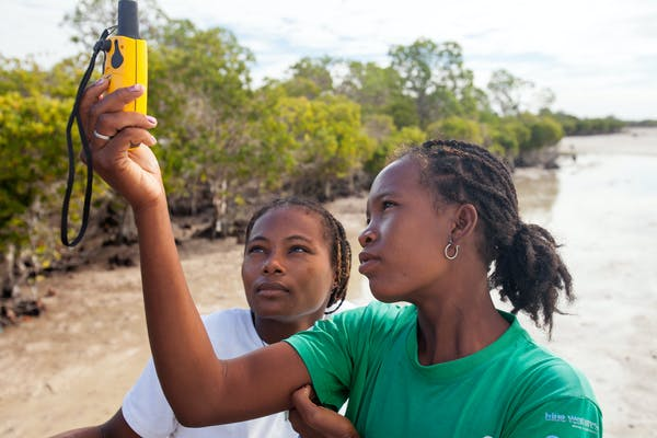 Community members using GPS to map mangrove forest in Lamboara, Madagascar. Photo credit: Garth Cripps/Blue Ventures.