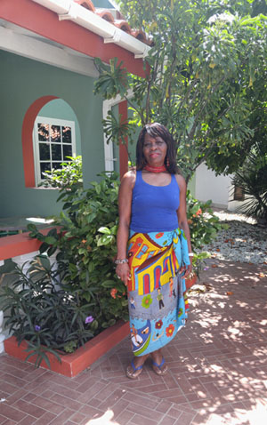 Just back from the beach, near one of her resorts in Aruba, where she spends her winters, Jean takes a relaxing pause, after her daily, strenuous, hour-long workout that includes a long walk, swimming and yoga -- before breakfast. Photo contributed.