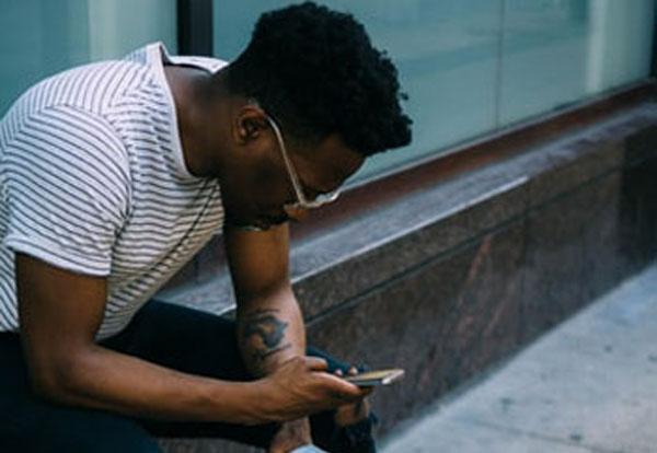 Negative beliefs about a partner affect how we interpret things like an unreturned text message. Photo credit: Derick Anies/Unsplash.