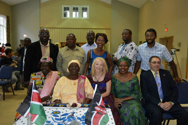 The late Mama Sarah Obama (front row, second from left) and her daughter, Marsat Onyango Obama (seated front row, left) on their visit to Ottawa, Canada, in May 2015 with. Looking on are (front row from right to left): Dave Feldman, Sarah Onyango and Peggy Taillon, of HERA Mission Canada. She was accompanied by her Communications Director, Ephraim Mwaura (standing far left), who is currently the Kenyan Canadian Association President. Photo courtesy of Marsat Onyango Obama.