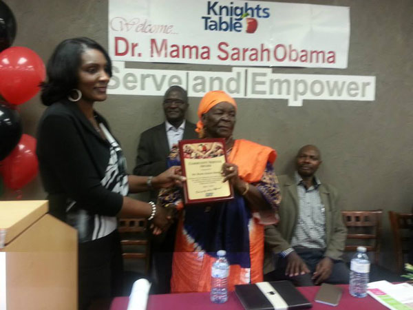 Mama Sarah Obama receives a Community Service Award in May 2015 from Knights Table Executive Director, Annie Bynoeat an event, held at their offices in Brampton, Ontario. Photo courtesy of Marsat Onyango Obama.