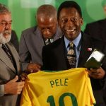 Pelé receives a jersey and ring from Brazil President Luiz Inácio Lula da Silva, known as Lula, at the Palácio do Planalto, in 2008, in commemoration of 50 years since the first World Cup title, won by Brazil in 1958. A new documentary explores the life of the legendary soccer player, against the backdrop of the country's politics, but it fails to ask the right questions about race and class. Photo credit: Fabio Rodrigues Pozzebom/ABr - Agência Brasil [1], CC BY 3.0.