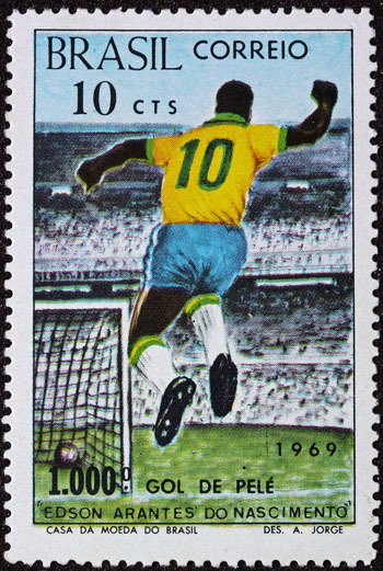 1969 Brazil postage stamp commemorating Pelé's landmark 1,000th goal. Born in Três Corações in 1940, Pelé has a street named after him in the city – Rua Edson Arantes do Nascimento. A statue of Pelé is also prominently placed in a plaza near the downtown area. Photo credit: By Brasil Correio - Selo postal, Public Domain.