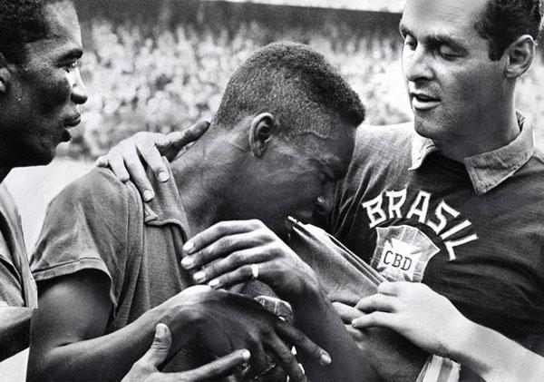 June 29, 1958: 17-year-old Pelé, left, weeps on the shoulder of goalkeeper, Gilmar Dos Santos Neves, after Brazil's 5-2 victory over Sweden in the World Cup final soccer match, in Stockholm, Sweden. Photo credit: By Aftonbladet, Public Domain.