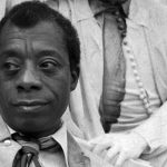 """American novelist and playwright, James Baldwin (Pictured at the Shakespeare Albert Memorial), in his book, """"No Name in the Street"""", asked: """"Does the law exist for the purpose of furthering the ambitions of those, who have sworn to uphold the law, or is it seriously, to be considered as a moral, unifying force -- the health and strength of a nation?"""" Photo by Allan Warren."""