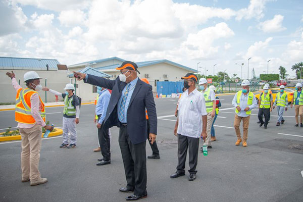 Minister of Public Works, Juan Edghill, inspects works at the CJIA in March.