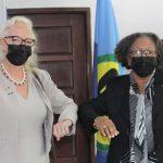 Secretary-General CARICOM, Dr. Carla Barnett (right), and the new United Kingdom Ambassador to CARICOM, Jane Miller, do the Covid-19-spawned handshake. Photo credit: CARICOM.