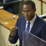Jamaica's Minister of Finance and the Public Service, Dr. Nigel Clarke, highlights a point, as he opened the debate on the first Supplementary Estimates of Expenditure for the 2021-22 fiscal year, during a sitting of the House of Representatives on Tuesday (October 12). Photo credit: Donald De La Haye/JIS.