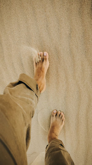 Walking on soft, but firm, sand, enjoying the melodic birdsong of the early morning are each gifts and benefits. Photo credit: Jose Aragones/Pexels.