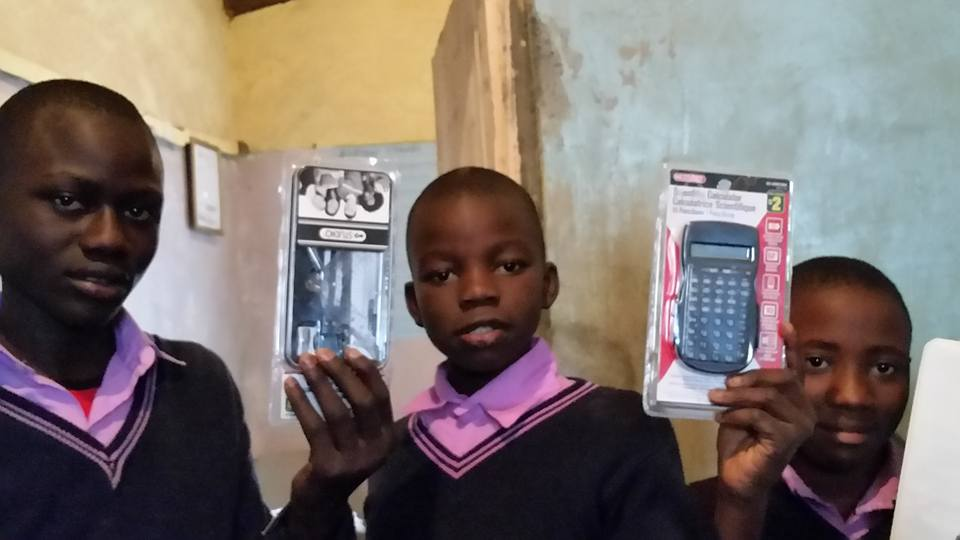Children received calculators and geometry set binders