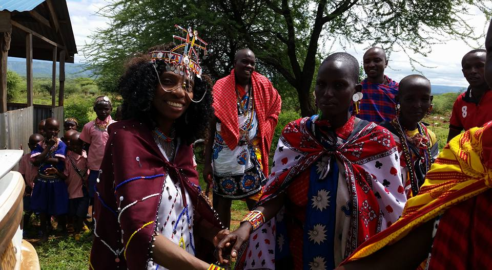 Morris is greeted by Massai women